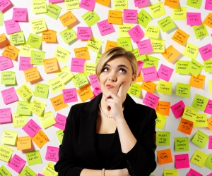 istock woman thinking postit notes businesswoman confused 15384568